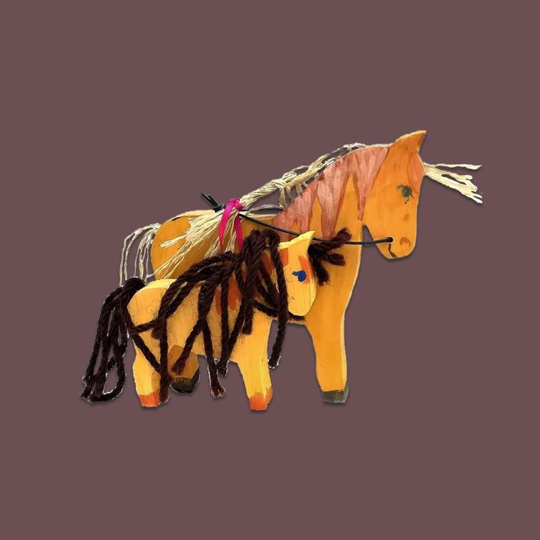 Das Pferd mit Fohlen